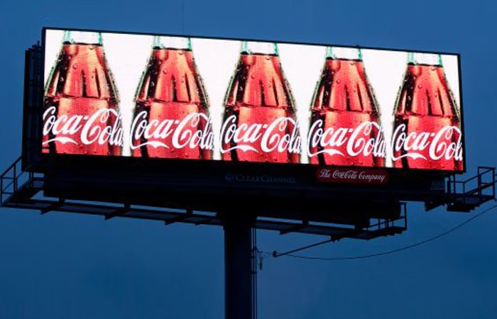 Coca Cola bottles repeated on a billboard