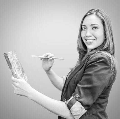 Cheryl Sinclair holding a paint brush and canvas