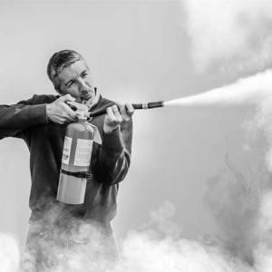 Kirk Wooldridge using a fire extinguisher