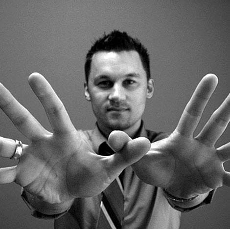 Sasha Gelemanovic with his hands spread wide