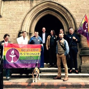Congregation pose outside the chapel with Pride flag on Leeds Pride.
