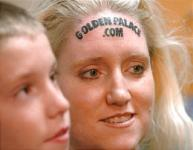 Golden Palace.com forehead tattoo