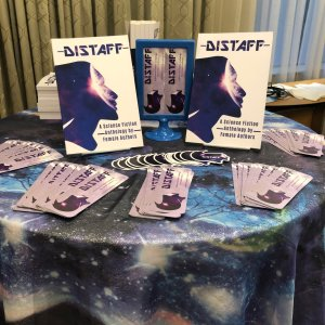 A photo featuring Distaff book, bookmarks and stickers