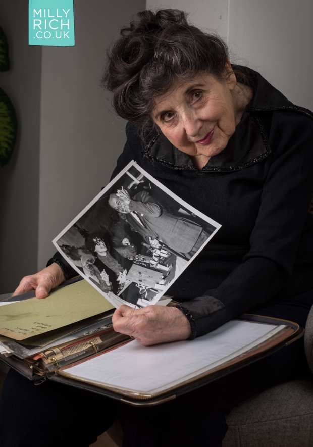 Milly Rich, 97, showing the photo of her and Cyril Fletcher in 1969, almost 50 years later