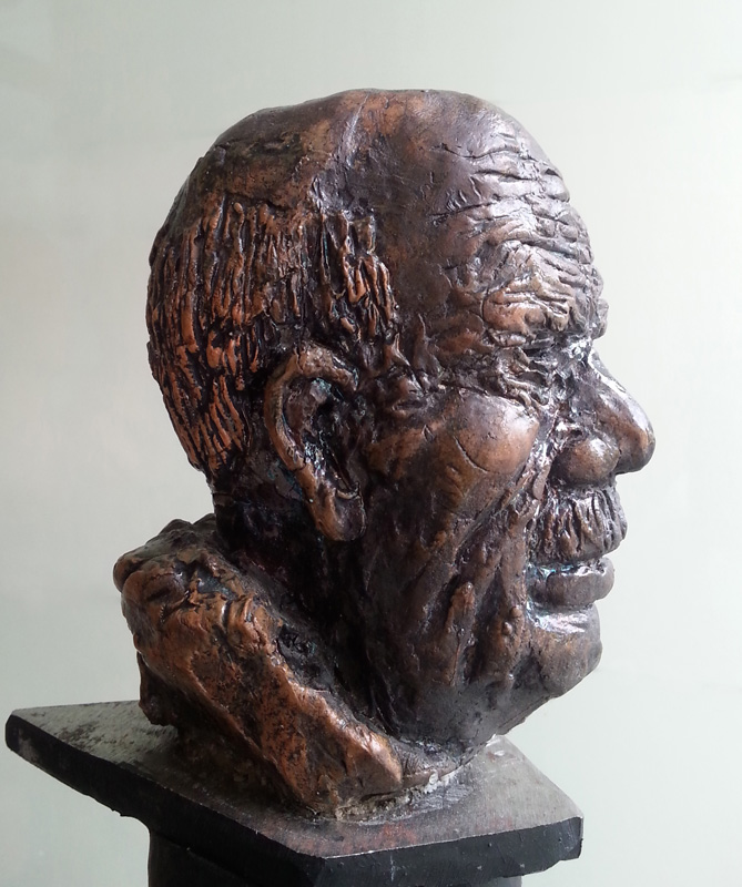 Raku sculpture. Characteristics attributed to old age: wisdom and serenity. Deeply-wrinkled face.