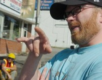 Shawn Gray of Milo points to location where Sunday's early morning fire started on Milo's Main Street. Gray, who lived in one of the destroyed buildings, alerted authorities to the blaze at about 3:20 AM.