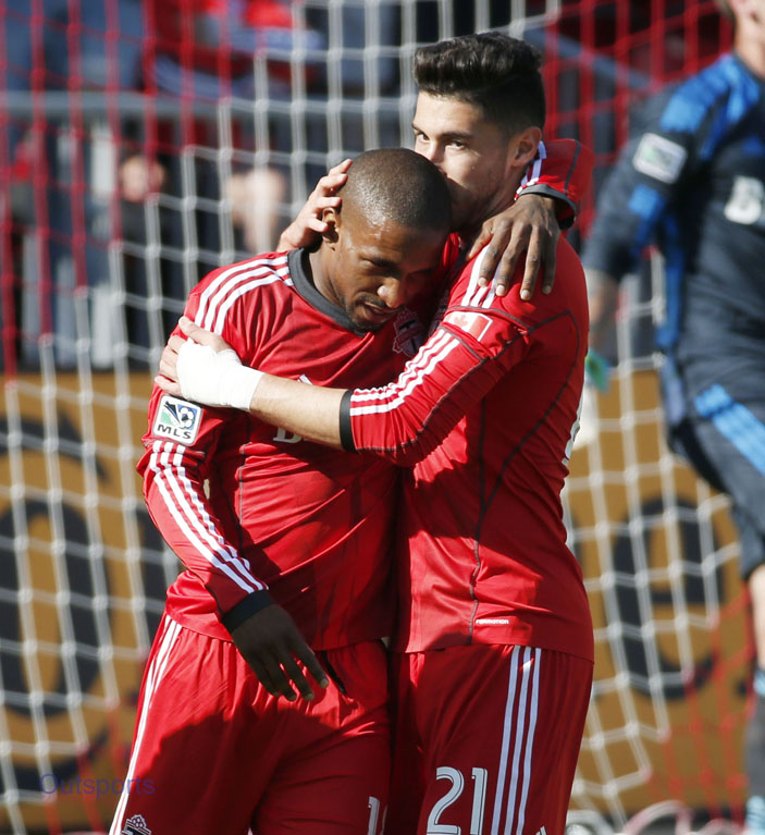 TORONTO, ON - MAY 31 - TFC's Jonathan Osorio (right) kisses Jermain Defoe after Defoe scored on a penalty kick during the 1st half of MLS action as the Toronto FC take on the Columbus Crew at BMO Field on May 31, 2014.