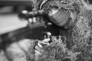 Closeup portrait of a sniper in camouflage