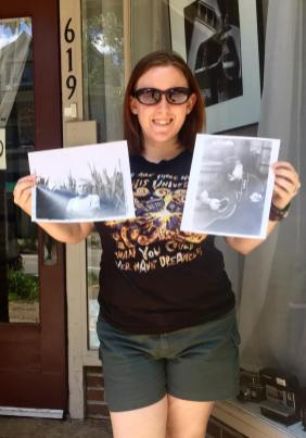 amanda with two film print portraits made in dark room