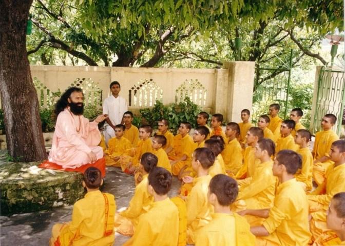 Guru teaching in a relaxed natural setting