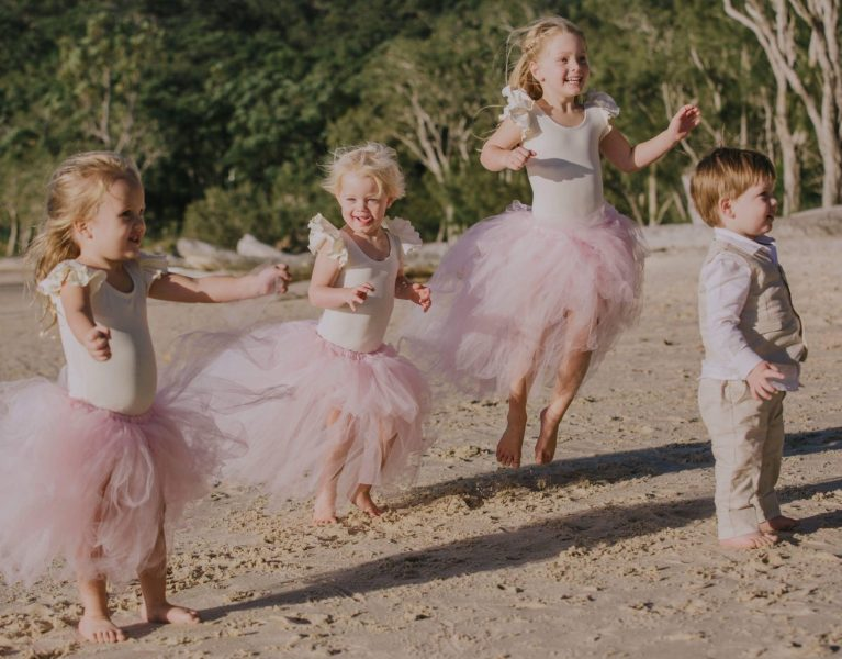 Little Bridesmaids in Mimosa Tutu Skirts at Fun Beach Wedding