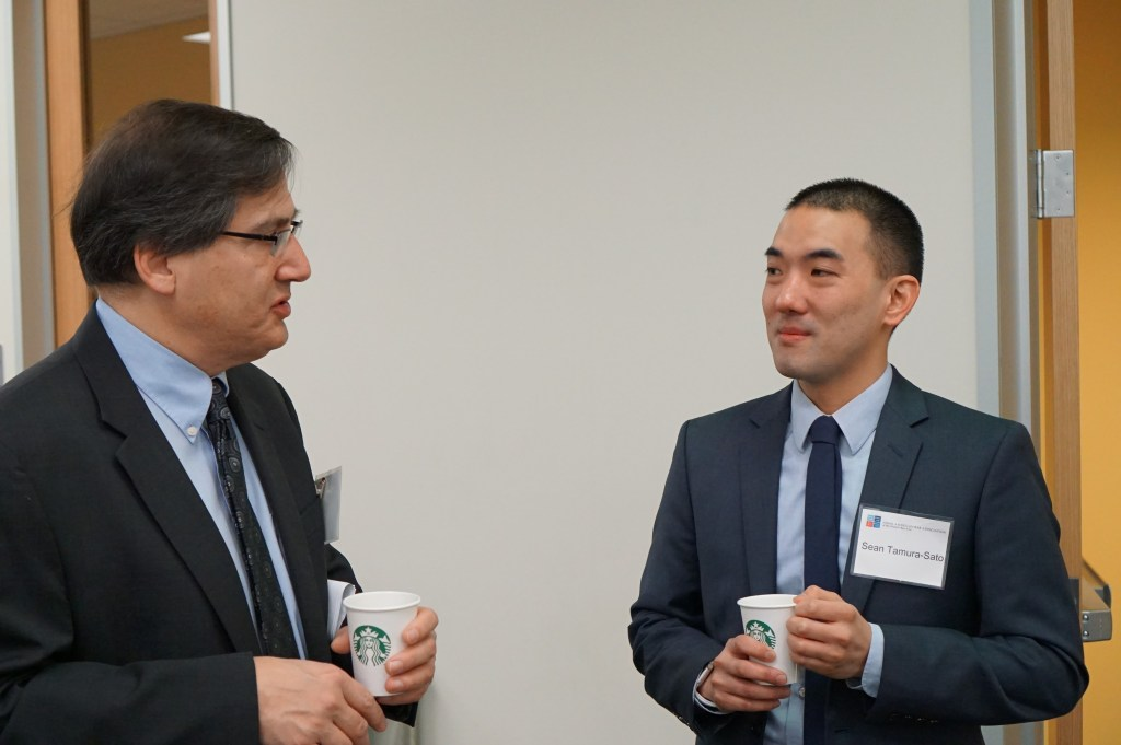 Minami Tamaki Associate Sean Tamura-Sato speakers with USF School of Law Dean John Trasviña.