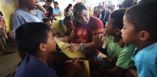 PSYCHOSOCIAL PROCESSING. A psychologist from the Center for Psychological Extension and Research Services (COPERS) of the Ateneo de Davao University interacts with one of the young survivors of Typhoon Pablo in New Bataan, Compostela Valley Province on Thursday, 27 December 2012 during a psychosocial processing with children of Purok 4. . COPERS' affiliates from Xavier University in Cagayan de Oro were part of the team. . MindaNews Photo by Ruby Thursday More