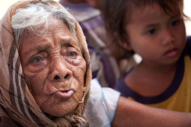 An old woman waits for her turn for consultation during a medical mission conducted by a team from the Department of Health - Region 10 in Barangay Palarao in the municipality of Leyte, Leyte on Wednesday (27 Nov 2013). MindaNews photo by Bobby Timonera
