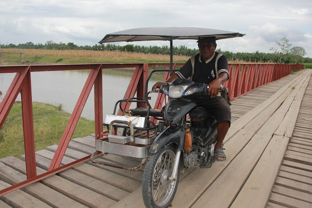 NEW BRIDGE. A tricycle passes through a newly constructed bridge in Barangay Tukanalipao, Mamasapano, Maguindanao province. The bridge makes it easier for residents to ferry their goods to the poblacion. MindaNews photo by TOTO LOZANO