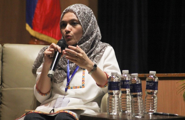 Shadia Marhaban co-founder of the Aceh Women's League shares her experience on transitions to peace in Aceh after the 2005 signing of the peace agreement during a symposium Titayan: Bridging for Peace at Ateneo de Davao University on April 21, 2016. MindaNews photo by TOTO LOZANO