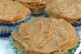 Healthy GF Orange Poppyseed Muffins with Sweet Caramel Frosting