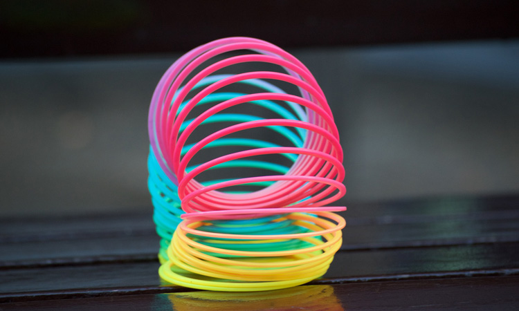 A colourful rainbow coloured Slinky toy