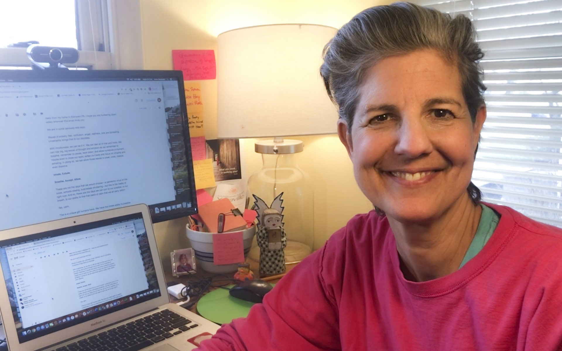 Anne Alexander sits in front of her desk at home - Mindful@Home