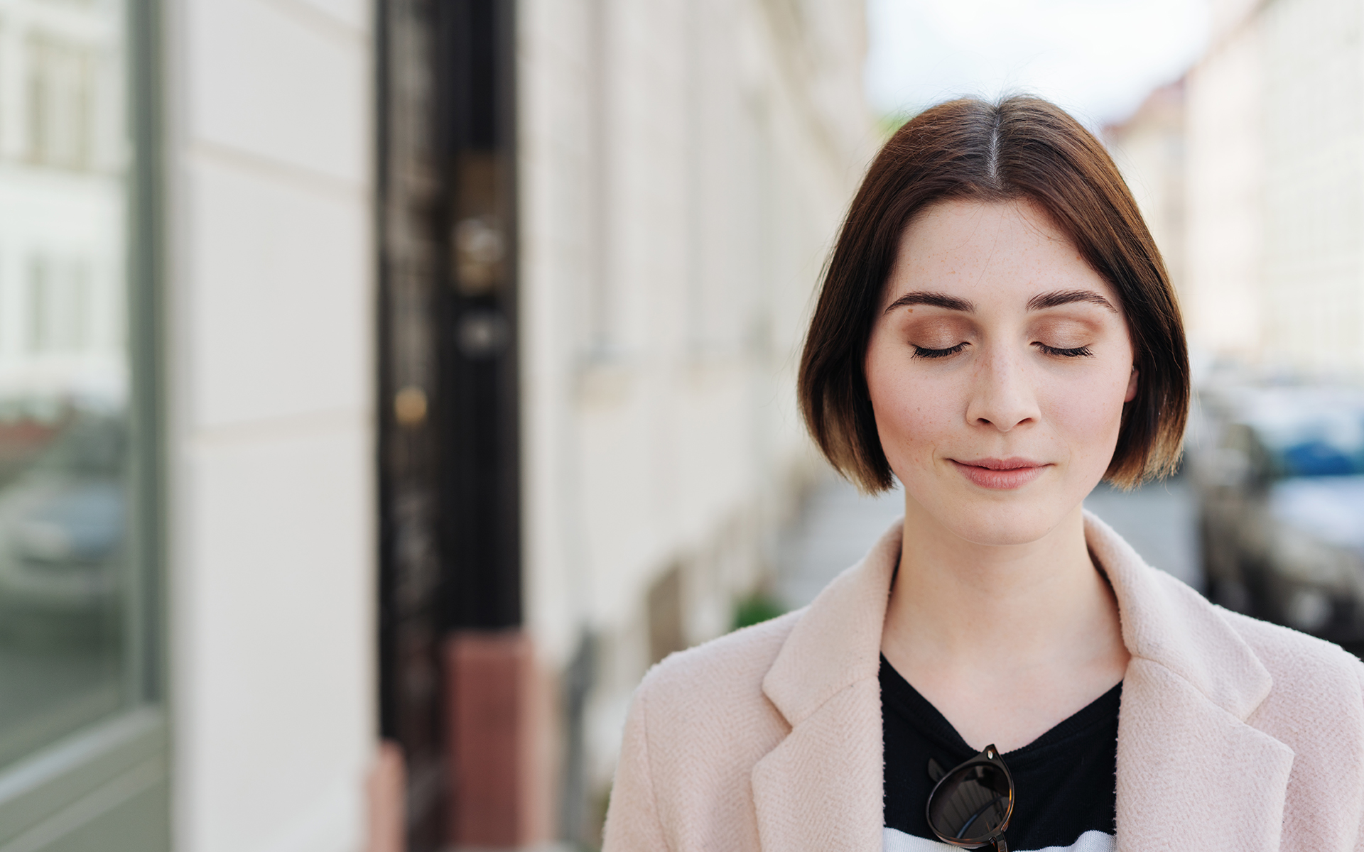 A 15-minute meditation to cultivate equanimity -Young woman standing with closed eyes
