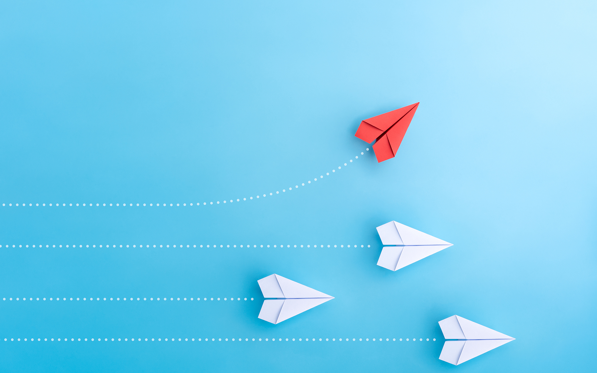 Finding Opportunities for Insight and Growth During Isolation - Group of paper plane in one direction and with one individual pointing in the different way. Business concept for new ideas creativity and innovative solution.