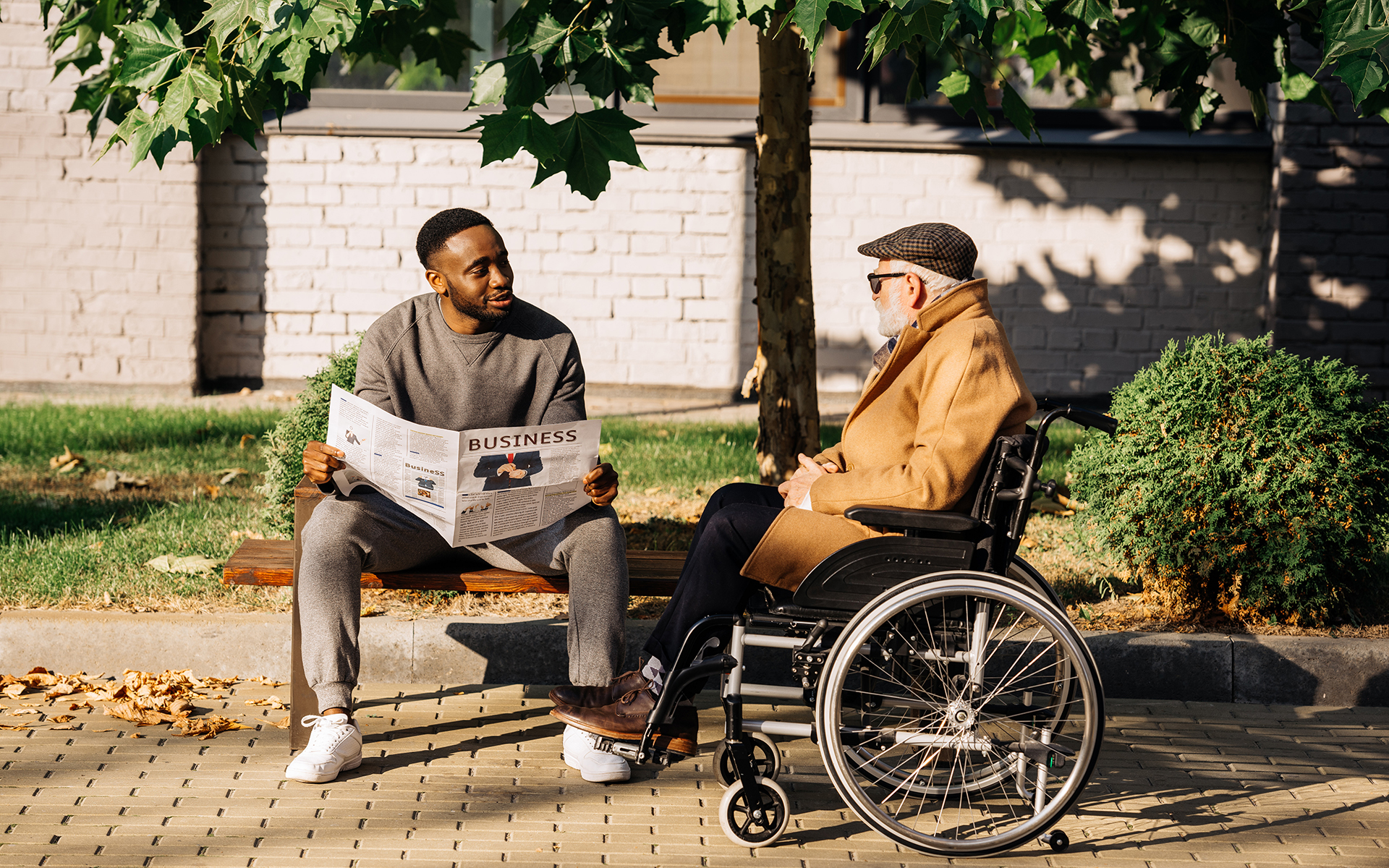 senior disabled man in wheelchair and african american man spend