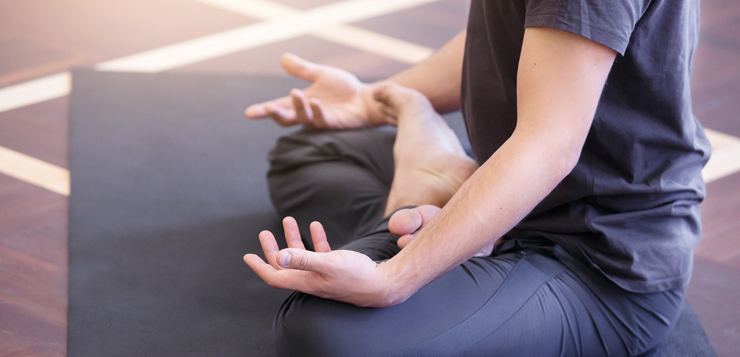 man in seated meditation pose