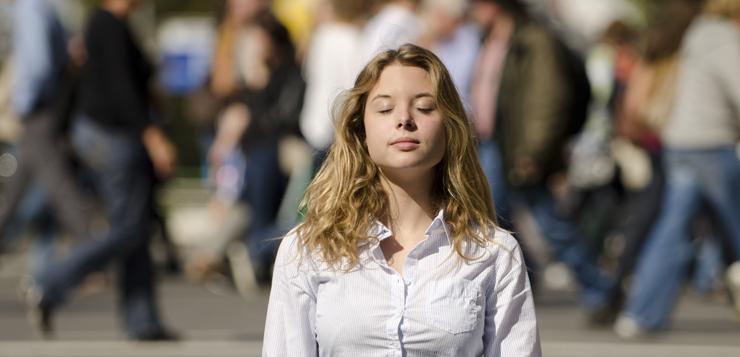 woman meditating in public