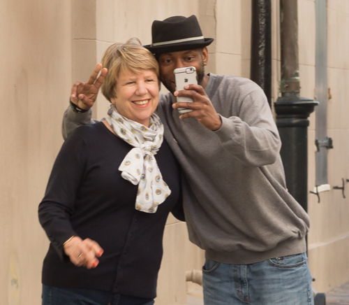 two people standing together, taking selfie
