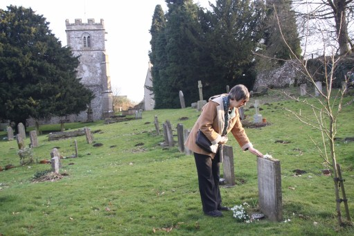 Frank Mansell - Diddley placing snowdrops on Frank's grave.