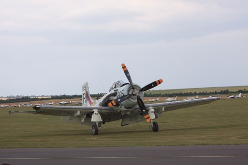 Flying Legends Duxford. Skyraider. Notice how much wing is missing, yet it still landed safely.