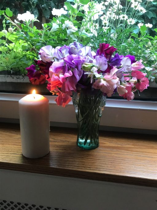 Heatwave: Candle and flowers.