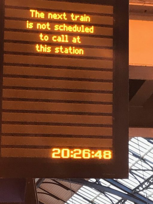 "Brighton: Sign reads: ""The next train is not scheduled to call at this station""!"