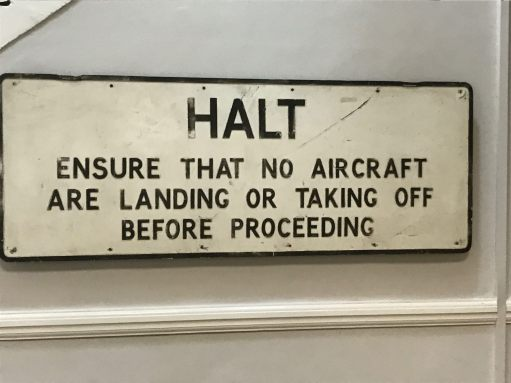 "Croydon Airport: ""Halt. Ensure that no Aircraft are landing or taking off before proceeding."""