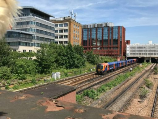 """The Footbridge: This train is running alongside the remains of """"Milk Dock"""". See later."""