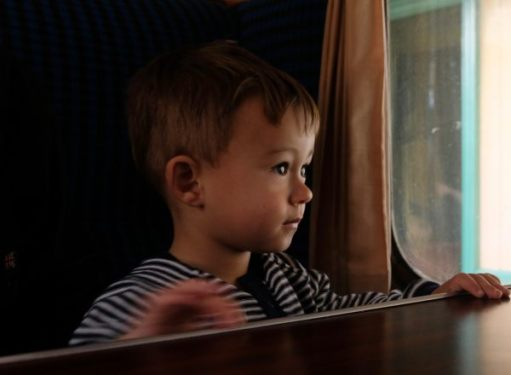 Tick tock. Look out of a train window, watching the world pass by. Little Jay, Bluebell Railway.