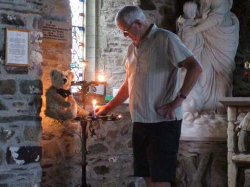 Tick tock. Lighting a candle in St Non's Chapel, St Davids, Pembrokeshire.