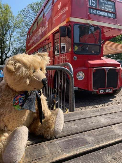 Me sat on Bobby's brother's tribute ppicnic bench and a Routemaster café.