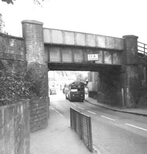 Worcester Park railway bridge as it was with a 213 RF just coming under it.
