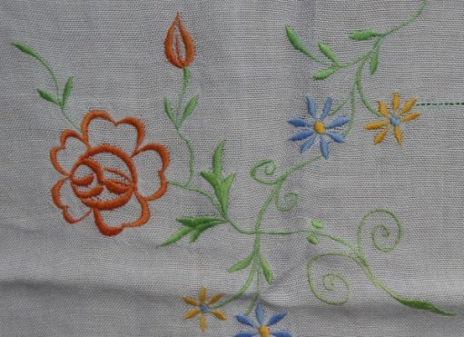 Embroidered flowers on table cloth.