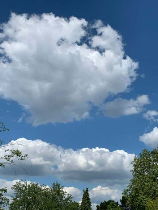 Large white clouds in an otherwise deep blue sky.