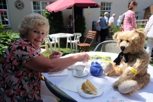 Bertie enjoying afternoon tea with Merrill.