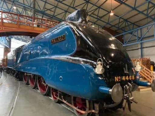 Mallard. A sleek, handsome streamlined steam locomotive. Deep blue, with gloss black front.