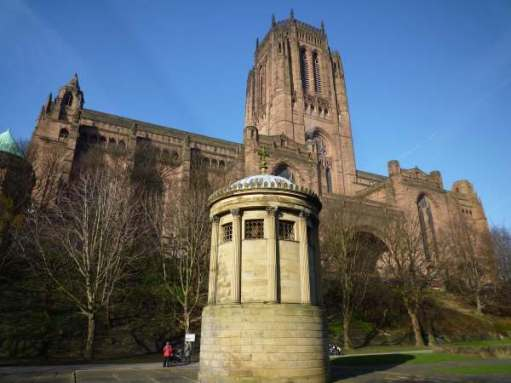 "The monument to William Huskisson MP, in front of Liverpool's Anglican Cathedral. The first man killed by a steam train. In an accident at the opening by ""Rocket"" of the Liverpool and Manchester Railway."