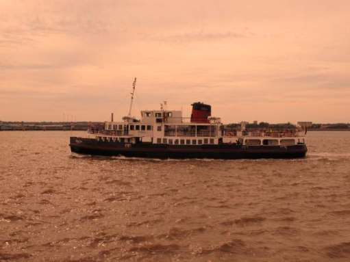 A Mersey Ferry in the evening sunlight heading back to Liverpool.