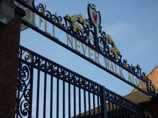 """You'll never walk alone"" in the ironwork of the gates at Liverpool Football Club."