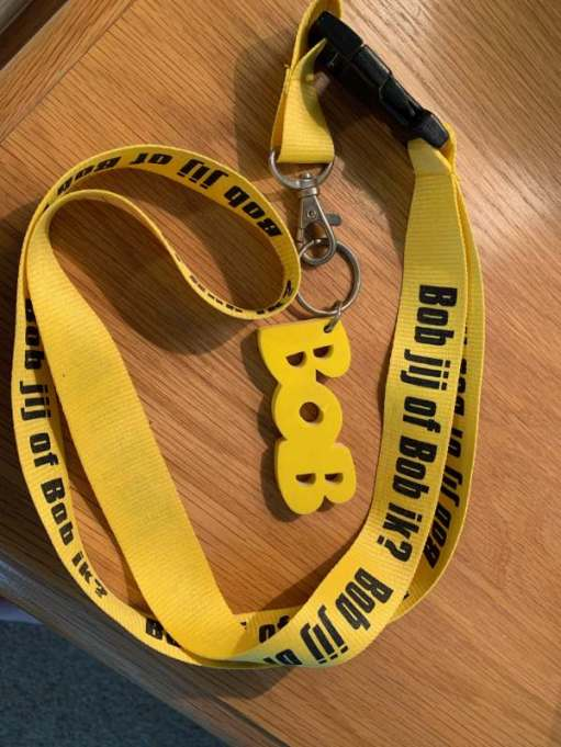 "The word Bob in yellow letters attached to a yellow lanyard, on which is written: ""Bob jij of Bob ik?"" It was from a Dutch drink/driving campaign."