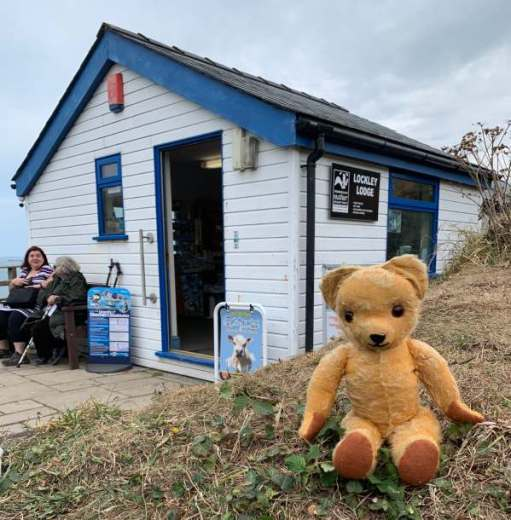 Eamonn sat outside Lockley Lodge - the Information Centre at Martin's Haven.