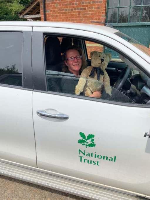 Bertie sat on Amanda's lap in the car/truck.