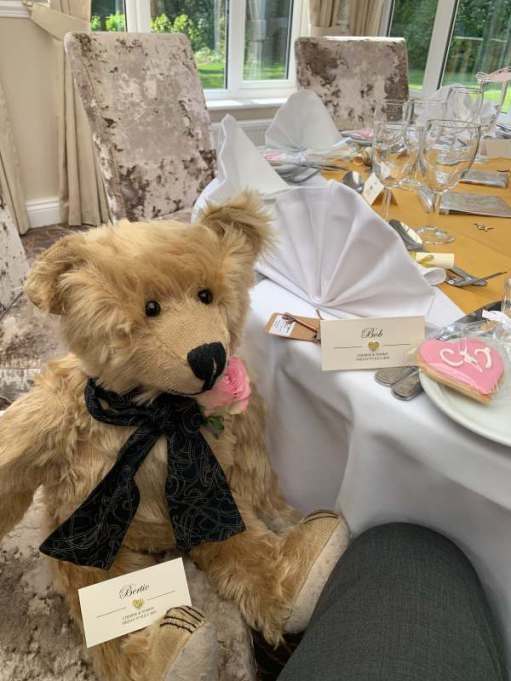 Bertie at the wedding breakfast table with his own place card.